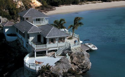 Blue Waters Antigua rock cottage close up sun deck beach view and speed boat