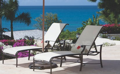 Blue Waters Antigua terrace sun loungers outdoor seating overlooking the ocean