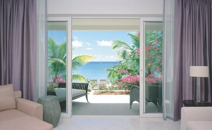 Carlisle Bay Antigua beach suite terrace sun loungers and ocean view