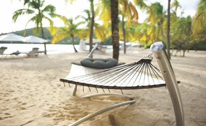 Carlisle Bay Antigua hammock on beach with palm trees