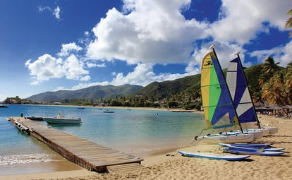Curtain Bluff Antigua beach with surf boards and paddle boards