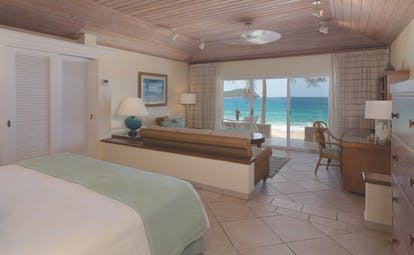 Curtain Bluff Antigua bedroom with glass doors leading to beach front