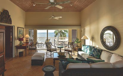 Curtain Bluff Antigua Grace Bay suite living room leading out to terrace overlooking the ocean