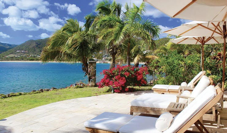 Curtain Bluff Antigua sunbeds looking out over the ocean