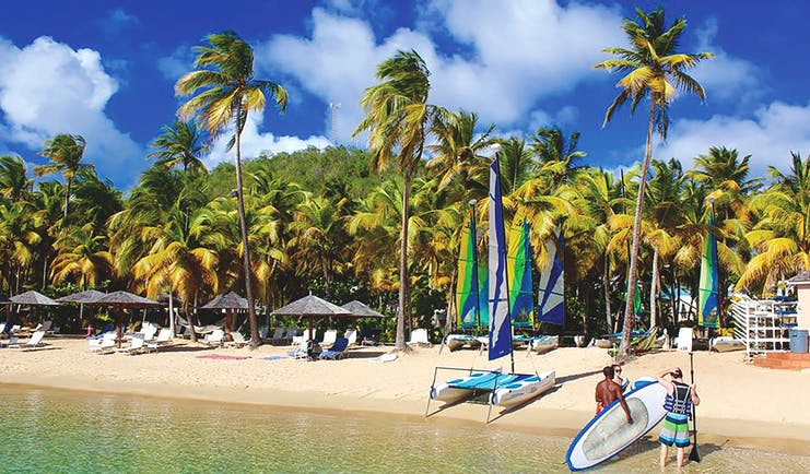 Curtain Bluff Antigua water sports on the beach surfing paddle boarding