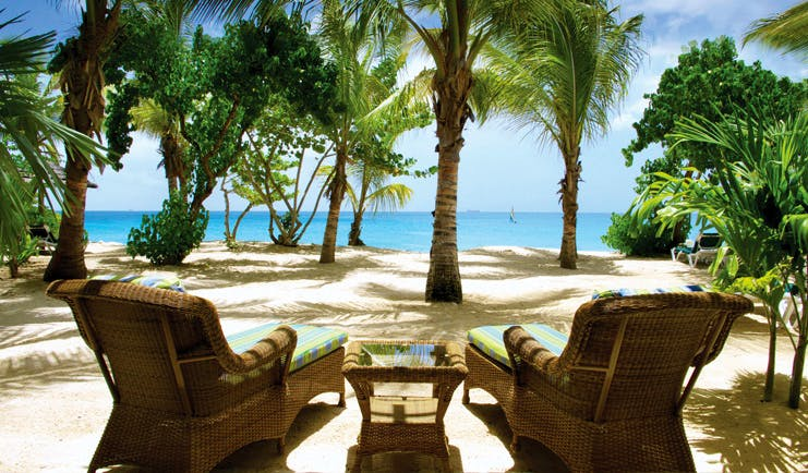 Galley Bay Antigua sun loungers overlooking ocean palm trees