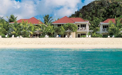 Galley Bay Antigua beach suites exterior buildings in background sea sandy beach