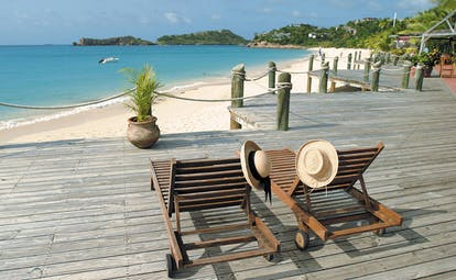Galley Bay Antigua beach terrace loungers overlooking beach coastline in distance