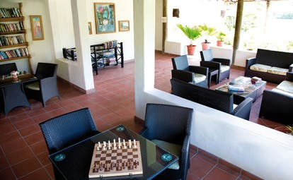 Galley Bay Antigua games room chess board book shelves communal indoor seating area