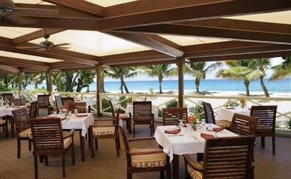 Galley Bay Antigua Ismays restaurant indoor dining modern décor overlooking beach