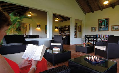 Galley Bay Antigua library woman reading communal indoor seating area modern décor