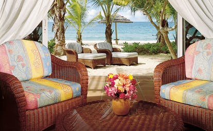 Galley Bay Antigua premium suite terrace armchairs leading to private beachfront terrace sun loungers
