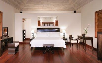 Hermitage Bay Antigua beach suite interior bed modern décor