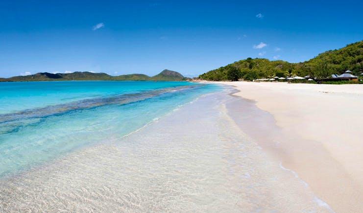 Hermitage Bay Antigua beach white sandy beach clear blue ocean