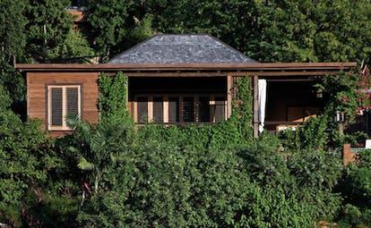Hermitage Bay Antigua hillside cottage exterior cottage nestled in hillside