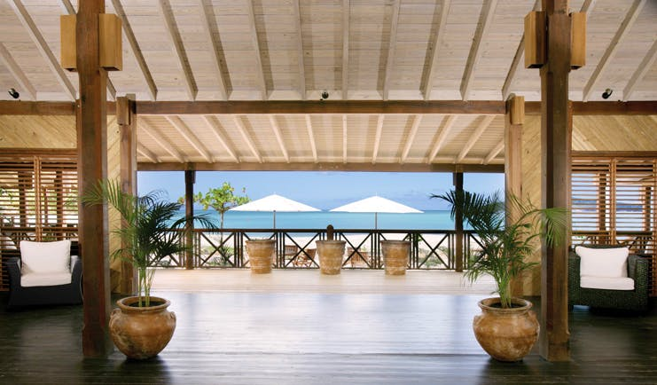Hermitage Bay Antigua lobby leading to terrace overlooking sea