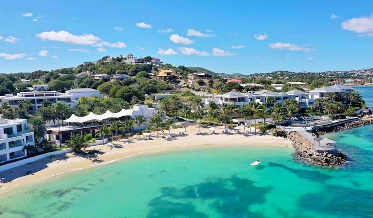 Aerial shot of Hodges Bay Resort, beach, white sand, hotel buildings
