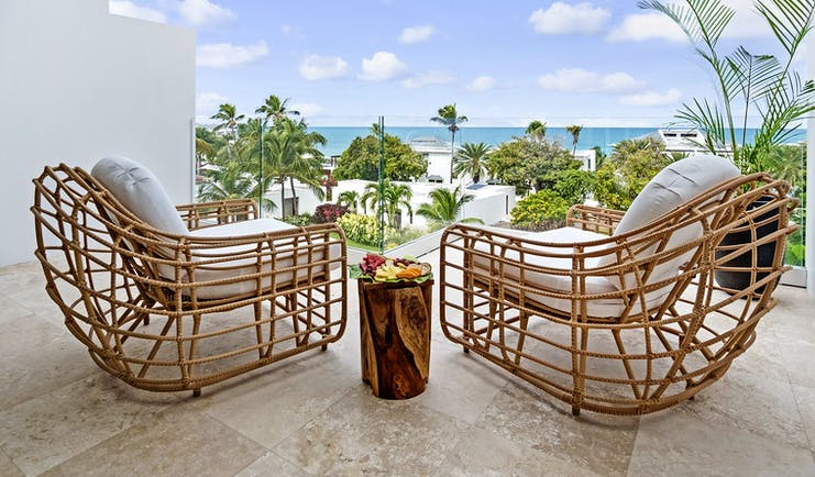 Hodges Bay Resort junior suite balcony, two armchairs, views overlooking the sea