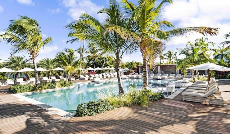 Hodges Bay Resort family pool, sun loungers, plam trees, decking