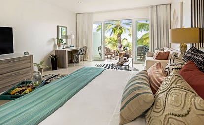 Hodges Bay Resort junior suite, double bed, bright modern decor, private balcony