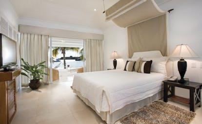 Inn at English Harbour Antigua beach cabana bedroom opening up to beach views