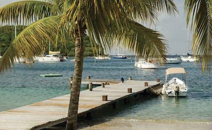 Inn at English Harbour Antigua beach jetty ocean palm trees boats