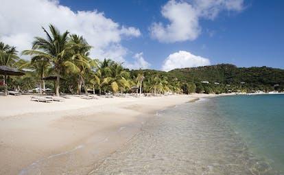 Inn at English Harbour Antigua beach ocean sandy beach sun loungers palm trees