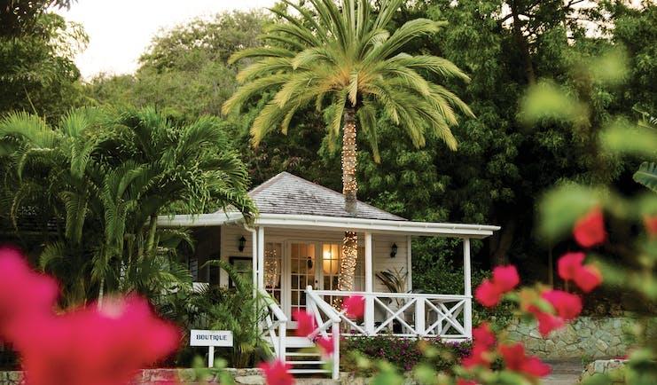 Inn at English Harbour Antigua boutique veranda palm trees red flowers
