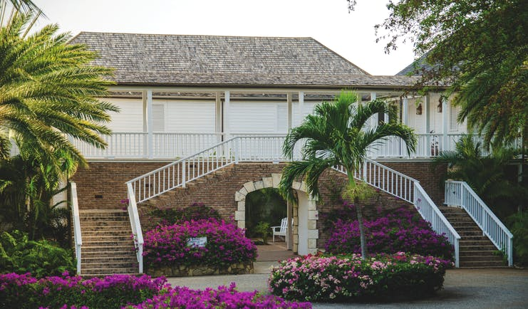 Inn at English Harbour Antigua hotel exterior purple flowers palm trees