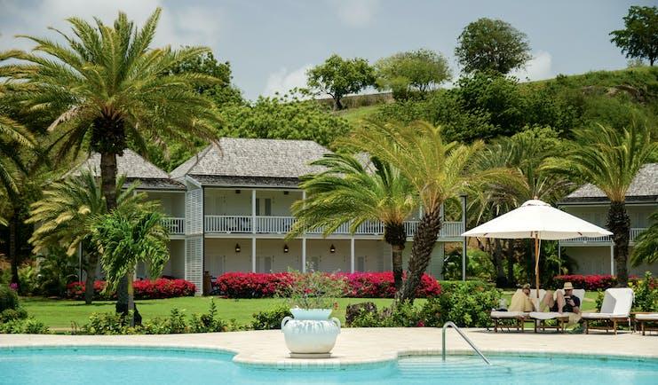 Inn at English Harbour Antigua pool sun loungers palm trees