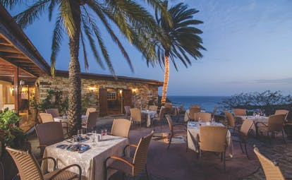 Inn at English Harbour Antigua restaurant outdoor dining by night overlooking the ocean