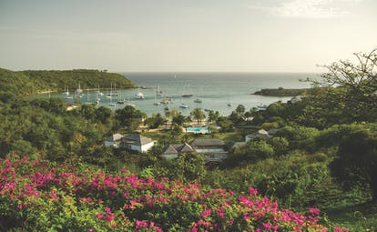 Inn at English Harbour Antigua scenery hotel complex overlooking sea boats on the water