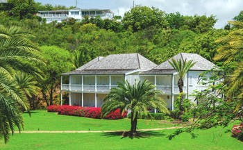 Inn at English Harbour Antigua exterior view palm trees lawn