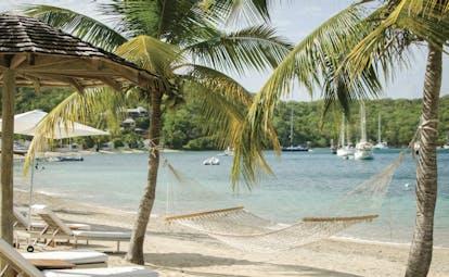 Inn at English Harbour Antigua hammock on beach beside the ocean palm trees