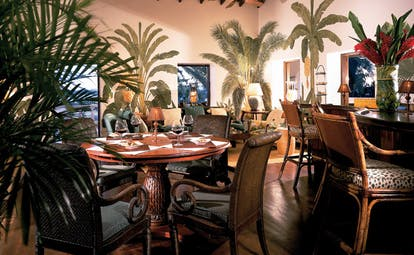Jumby Bay Antigua estate house bar indoor seating area elegant décor