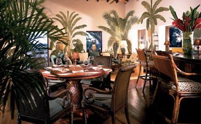 Jumby Bay Antigua estate house bar indoor seating area elegant décor