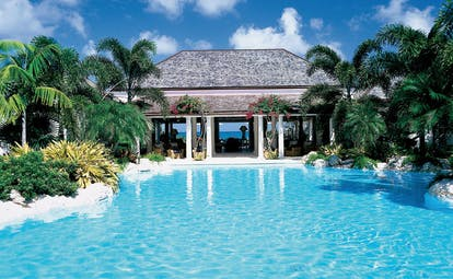 Jumby Bay Antigua hawks bill cove pool private pool palm trees