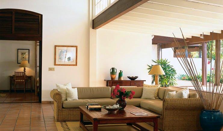 Jumby Bay Antigua lounge indoor seating area sofas modern décor