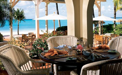 Jumby Bay Antigua restaurant dining area on beach front