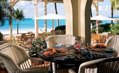 Jumby Bay Antigua restaurant dining area on beach front