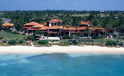 Jumby Bay Antigua villa exteriors buildings on beachfront white sandy beach