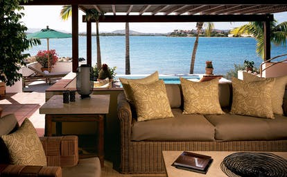 Jumby Bay Antigua villa terrace sofa pool overlooking sea