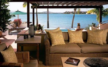 Jumby Bay Antigua villa terrace sofa pool overlooking sea