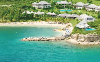 Nonsuch Bay Antigua aerial view of resort beach and jetty