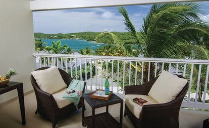 Nonsuch Bay Antigua deluxe suite terrace outdoor seating area with ocean views