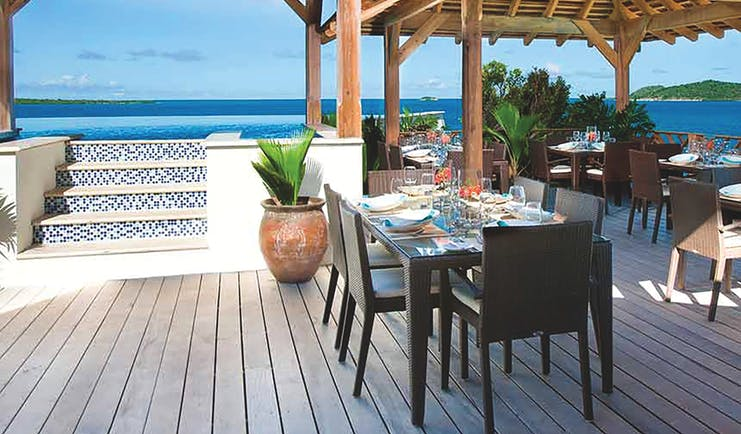 Nonsuch Bay Antigua dining overlooking ocean dining beside infinity pool