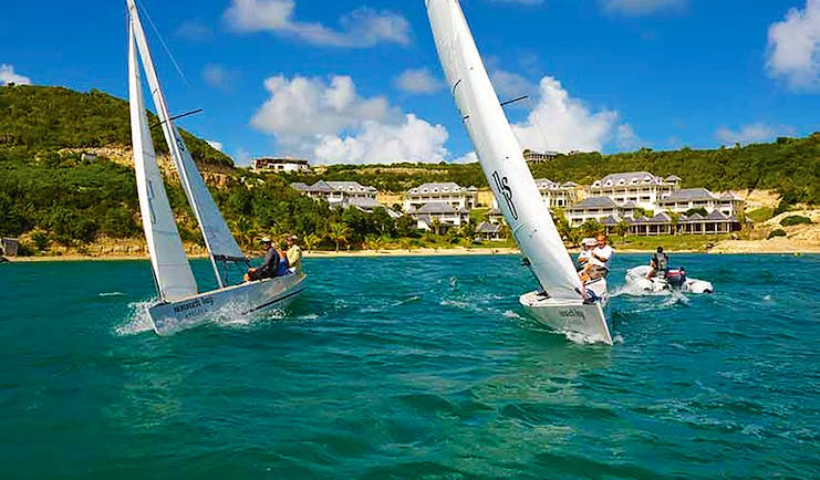 Nonsuch Bay Antigua sailing three boats beach and hotel in background