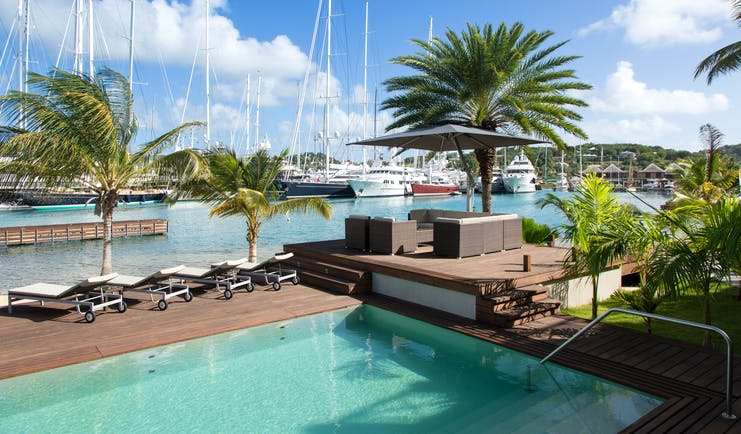 South Point pool deck, swimming pool, sun loungers, deck overlooking harbour