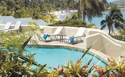St James's Club Antigua adult pool sun loungers beach views