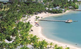 St James's Club Antigua aerial shot of beach sand sea palm trees jetty boats